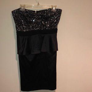 Black sequins and satin strapless dress